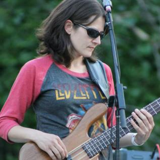 Cheryl McNamee, bass guitar